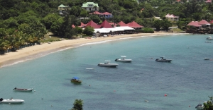 View of the crystal clear bay at St. Barts with boats anchored.