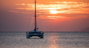 Sailing Boat and Catamaran at Sunset